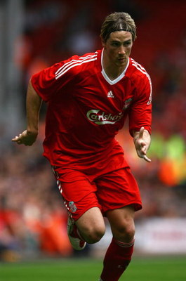 LIVERPOOL, ENGLAND - AUGUST 08:  Fernando Torres of Liverpool in action during the friendly match between Liverpool and Atletico Madrid at Anfield on August 8, 2009 in Liverpool, England. (Photo by Alex Livesey/Getty Images)