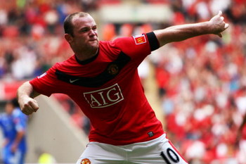 LONDON, ENGLAND - AUGUST 09:  Wayne Rooney of Manchester United celebrates as he scores their second goal during the FA Community Shield match between Manchester United and Chelsea at Wembley Stadium on August 9, 2009 in London, England.  (Photo by Jamie