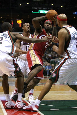 MILWAUKEE - FEBRUARY 20:  LeBron James #23 of the Cleveland Cavaliers looks to pass under pressure from (L-R) Luc Richard Mbah a Moute #12, Keith Bogans #10 and Charlie Villanueva #31 of the Milwaukee Bucks on February 20, 2009 at the Bradley Center in Mi