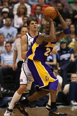 SALT LAKE CITY - APRIL 25:  Kobe Bryant #24 of the Los Angeles Lakers looks to pass under pressure from Kyle Korver #26 of the Utah Jazz in Game Four of the Western Conference Quarterfinals during the 2009 NBA Playoffs at Energy Solutions Arena on April 2