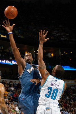 NEW ORLEANS - DECEMBER 30:  Antawn Jamison #4 of the Washington Wizards takes a shot over David West #30 of the New Orleans Hornets on December 30, 2008 at the New Orleans Arena in New Orleans, Louisiana.  NOTE TO USER: User expressly acknowledges and agr