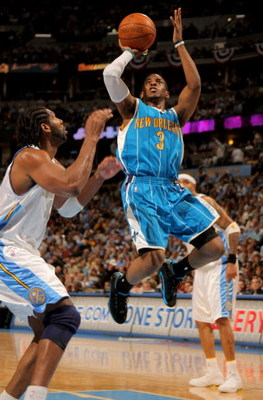 DENVER - APRIL 29:  Chris Paul #3 of the New Orleans Hornets takes a shot Nene #31 of the Denver Nuggets defends in Game Five of the Western Conference Quarterfinals during the 2009 NBA Playoffs at Pepsi Center on April 29, 2009 in Denver, Colorado. The N