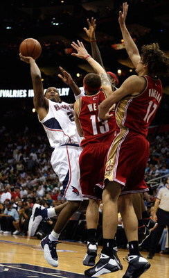 ATLANTA - MAY 09:  Joe Johnson #2 of the Atlanta Hawks shoots against Delonte West #13 and Anderson Varejao #17 of the Cleveland Cavaliers in Game Three of the Eastern Conference Semifinals during the 2009 NBA Playoffs at Philips Arena on May 9, 2009 in A
