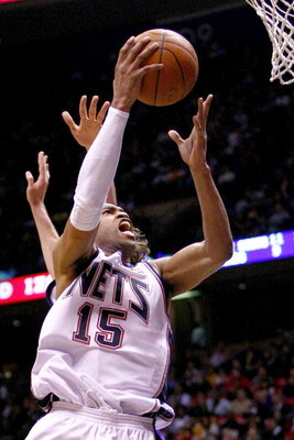 EAST RUTHERFORD, NJ - MARCH 27:  Vince Carter #15 of the New Jersey Nets drives to the basket against the Los Angeles Lakers during their game on March 27, 2009 at the Izod Center in East Rutherford, New Jersey. NOTE TO USER: User expressly acknowledges a
