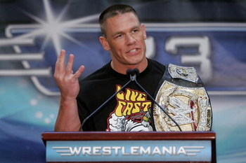 NEW YORK - MARCH 28:  Wrestler John Cena speaks at the press conference held by Battle of the Billionaires to announce details of Wrestlemania 23 at Trump Tower on March 28, 2007 in New York City.  (Photo by Bryan Bedder/Getty Images)