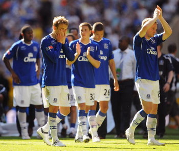 LONDON, ENGLAND - MAY 30:  Phil Neville (2L) and Everton team mates look dejected after defeat during the FA Cup sponsored by E.ON Final match between Chelsea and Everton at Wembley Stadium on May 30, 2009 in London, England.  (Photo by Shaun Botterill/Ge