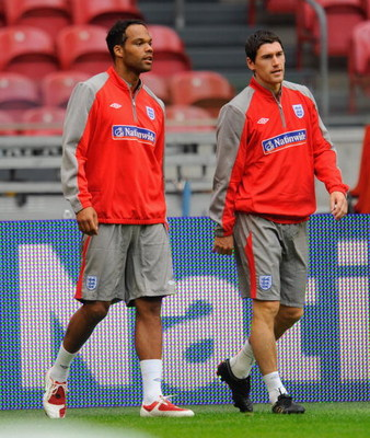 AMSTERDAM, NETHERLANDS - AUGUST 11:  Joleon Lescott walks with Gareth Barry during the England Training Session at the Amsterdam Arena on August 11, 2009 in Amsterdam, Netherlands.  (Photo by Michael Regan/Getty Images)