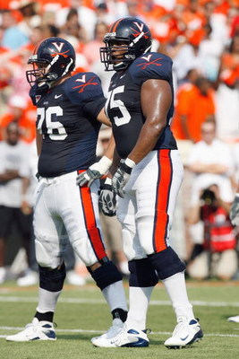 CHARLOTTESVILLE, VA - AUGUST 30:  Zak Stair #76 and Eugene Monore #75 of the Virginia Cavaliers stand on the field during the game against the Southern California Trojans during the game at Scott Stadium on August 30, 2008 in Charlottesville, Virginia.  (