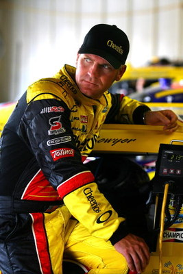 BROOKLYN, MI - AUGUST 15:  Clint Bowyer, sits on the #33 Hamburger Helper/Cheerios Chevrolet in the garage prior to practice for the NASCAR Sprint Cup Series Michigan 400 at Michigan Internetional Speedway on August 15, 2009 in Brooklyn, Michigan.  (Photo