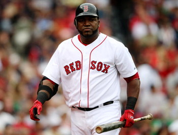 BOSTON - AUGUST 13:  David Ortiz #34 of the Boston Red Sox reacts after striking out in the ninth inning during the game against the Detroit Tigers at Fenway Park on August 13, 2009 in Boston, Massachusetts. (Photo by Elsa/Getty Images)