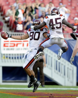 TAMPA, FL - DECEMBER 6: Defensive end Orion Martin #90 of the Virginia Tech Hokies celebrates a fumble recovery for a touchdown against the Boston College Eagles in the 2008 ACC Football Championship game at Raymond James Stadium on December 6, 2008 in Ta