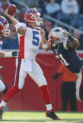 FOXBORO, MA - NOVEMBER 09:  Trent Edwards #5 of the Buffalo Bills is pressured by Jerod Mayo #51 of the New England Patriots on November 9, 2008 at Gillette Stadium in Foxboro, Massachusetts.  (Photo by Elsa/Getty Images)