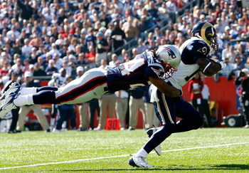 FOXBORO, MA - OCTOBER 26:  Donnie Avery #17 of the St. Louis Rams is stopped by Jonathan Wilhite #24 of the New England Patriots at Gillette Stadium on October 26, 2008 in Foxboro, Massachusetts.  (Photo by Jim Rogash/Getty Images)