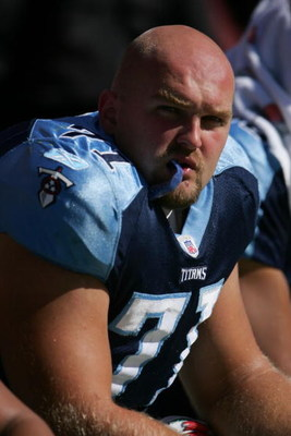 WASHINGTON ? OCTOBER 15:  Tackle Michael Roos #71 of the Tennessee Titans watches the game against the Washington Redskins on October 15, 2006 at FedExField in Landover, Maryland. The Titans won 25-22.  (Photo by Chris McGrath/Getty Images)