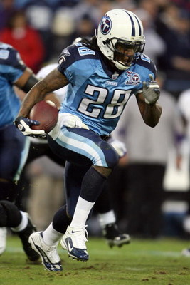 NASHVILLE, TN - JANUARY 10:  Running back Chris Johnson #28 of the Tennessee Titans runs the ball in the first quarter against the Baltimore Ravens during the AFC Divisional Playoff Game on January 10, 2009 at LP Field in Nashville, Tennessee.  (Photo by