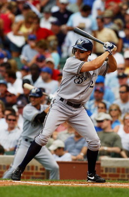CHICAGO - JULY 16:  Scott Podsednik #20 of the Milwaukee Brewers bats during a game against the Chicago Cubs on July 16, 2004 at Wrigley Field in Chicago, Illinois.  The Brewers defeated the Cubs 3-2.  (Photo by Jonathan Daniel/Getty Images)