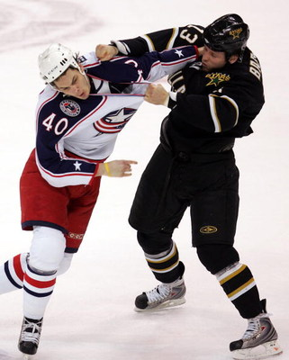 DALLAS - JANUARY 22:  Right wing Jared Boll #40 of the Columbus Blue Jackets fights with Krystofer Barch #13 of the Dallas Stars in the first period at the American Airlines Center on January 22, 2008 in Dallas, Texas.  (Photo by Ronald Martinez/Getty Ima