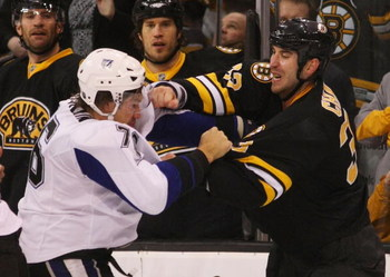 BOSTON - MARCH 31:  Evgeny Artyukhin #76 of the Tampa Bay Lightning and Zdeno Chara #33 of the Boston Bruins exchange blows on March 31, 2009 at the TD Banknorth Garden in Boston.  (Photo by Bruce Bennett/Getty Images)