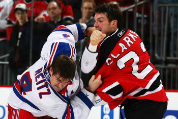 NEWARK, NJ - FEBRUARY 09:  David Clarkson #23 of the New Jersey Devils fights Erik Reitz #4 of the New York Rangers during their game on February 9, 2009 at The Prudential Center in Newark, New Jersey  (Photo by Al Bello/Getty Images)
