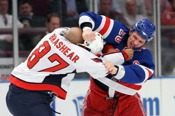 NEW YORK - FEBRUARY 11:  Colton Orr #28 of the New York Rangers fights with Donald Brashear #87 of the Washington Capitals on February 11, 2009 at Madison Square Garden in New York City, New York.  (Photo by Nick Laham/Getty Images)