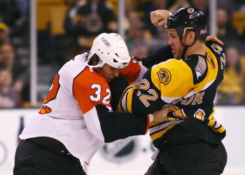 BOSTON - OCTOBER 27:  Shawn Thornton #22 of the Boston Bruins and Riley Cote #32 of the Philadelphia Flyers exchange punches on October 27, 2007 at the TD Banknorth Garden in Boston, Massachusetts. The Flyers defeated the Bruins 2-1.  (Photo by Elsa/Getty
