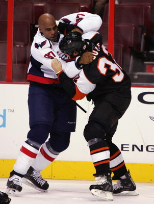 PHILADELPHIA - SEPTEMBER 26: Riley Cote #32 of the Philadelphia Flyers fights Donald Brashear #87 of the Washington Capitals during the NHL preseason game on September 26, 2007 at Wachovia Center in Philadelphia, Pennsylvania. (Photo by Jim McIsaac/Getty