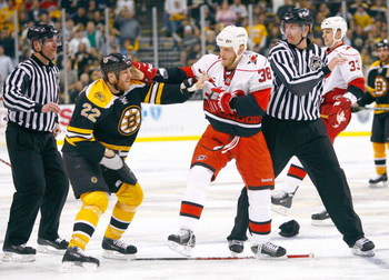 BOSTON - MAY 10: Shawn Thornton #22 of the Boston Bruins exchange punches with Tim Conboy #38 of the Carolina Hurricanes the during Game Five of the Eastern Conference Semifinal Round of the 2009 Stanley Cup Playoffs on May 10, 2009 at the TD Banknorth Ga