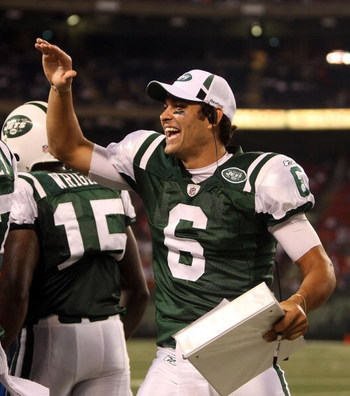 EAST RUTHERFORD, NJ - AUGUST 14:  Mark Sanchez #6 of the New York Jets celebrates a touchdown against the St. Louis Rams during their preseason game at Giants Stadium on August 14, 2009  in East Rutherford, New Jersey.  (Photo by Nick Laham/Getty Images)