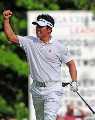 CHASKA, MN - AUGUST 16:  Y.E. Yang of South Korea celebrates after holing out for eagle on the 14th hole during the final round of the 91st PGA Championship at Hazeltine National Golf Club on August 16, 2009 in Chaska, Minnesota.  (Photo by Stuart Frankli