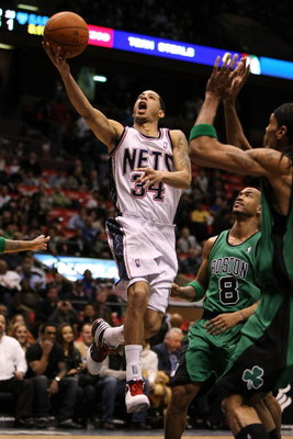 EAST RUTHERFORD, NJ - MARCH 04:  Devin Harris #34 of the New Jersey Nets shoots the ball against Stephon Marbury #8 of the Boston Celtics during their game on March 4, 2009 at The Izod Center in East Rutherford, New Jersey.  NOTE TO USER: User expressly a