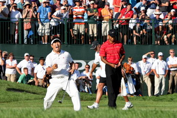 CHASKA, MN - AUGUST 16:  (L-R) Y.E. Yang of South Korea celebrates a birdie putt on the 18th green alongside Tiger Woods during the final round of the 91st PGA Championship at Hazeltine National Golf Club on August 16, 2009 in Chaska, Minnesota.  (Photo b