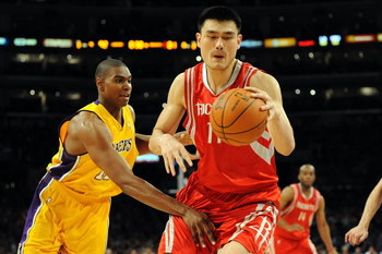 LOS ANGELES, CA - MAY 06:  Yao Ming #11 of the Houston Rockets moves the ball against Andrew Bynum #17 of the Los Angeles Lakers in Game Two of the Western Conference Semifinals during the 2009 NBA Playoffs at Staples Center on May 6, 2009 in Los Angeles,