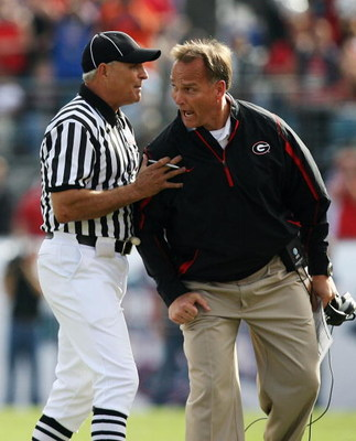 JACKSONVILLE, FL - NOVEMBER 01:  Linesman Lane Thomas holds back head coach Mark Richt of the Georgia Bulldogs after a call went against the Bulldogs while taking on the Florida Gators at Jacksonville Municipal Stadium on November 1, 2008 in Jacksonville,
