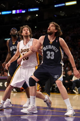 LOS ANGELES, CA - APRIL 12:  Marc Gasol #33 of the Memphis Grizzlies and Pau Gasol #16 of the Los Angeles Lakers battle for position under the basket on April 12, 2009 at Staples Center in Los Angeles, California. NOTE TO USER: User expressly acknowledges