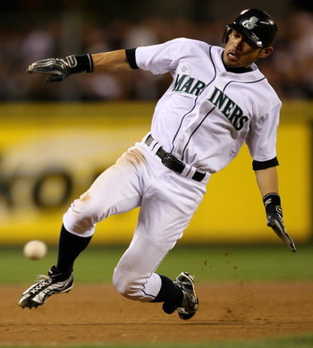 SEATTLE  - AUGUST 15:  Ichiro Suzuki #51 of the Seattle Mariners slides into third base on a steal attempt against the New York Yankees on August 15, 2009 at Safeco Field in Seattle, Washington. Suzuki was out on the play. (Photo by Otto Greule Jr/Getty I