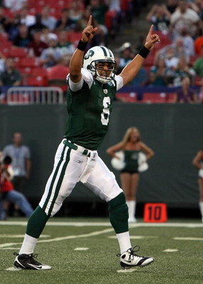 EAST RUTHERFORD, NJ - AUGUST 14:  Mark Sanchez #6 of the New York Jets celebrates his first touchdown during the preseason game against the St. Louis Rams at Giants Stadium on August 14, 2009  in East Rutherford, New Jersey.  (Photo by Nick Laham/Getty Im