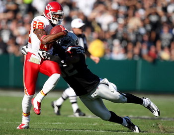 OAKLAND, CA - NOVEMBER 30: Dwayne Bowe #82 of the Kansas City Chiefs catches a pass over Kirk Morrison #52 of the Oakland Raiders during an NFL game on November 30, 2008 at the Oakland-Alameda County Coliseum in Oakland, California. (Photo by Jed Jacobsoh