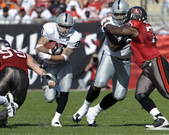 TAMPA, FL - DECEMBER 28: Running back Justin Fargus #25 of the Oakland Raiders rushes upfield against the Tampa Bay Buccaneers at Raymond James Stadium on December 28, 2008 in Tampa, Florida.  (Photo by Al Messerschmidt/Getty Images)