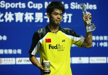 SHANGHAI, CHINA - NOVEMBER 23: (CHINA OUT) Lin Dan of China celebrates with his trophies after winning the men's singles finals badminton match against Chong Wei Lee of Malaysia during the 2008 Li-Ning China Open BWF Super Series on November 23, 2008 in S
