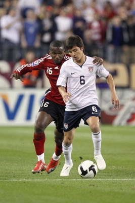 NASHVILLE, TN - APRIL 1:  Jose Francisco Torres #6 of the United States controls the ball under pressure from Khaleem Hyland #16 of Trinidad and Tobago during a FIFA 2010 World Cup Qualifying match on April 1, 2009 at LP Field in Nashville, Tennessee. The