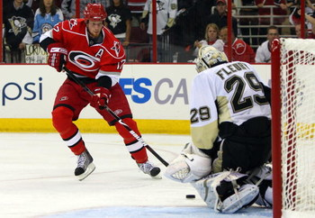 RALEIGH, NC - MAY 26:  Goaltender Marc-Andre Fleury #29 of the Pittsburgh Penguins saves a shot on goal by Eric Staal #12 of the Carolina Hurricanes during Game Four of the Eastern Conference Championship Round of the 2009 Stanley Cup Playoffs at RBC Cent