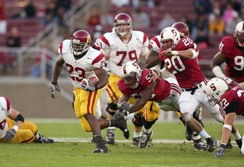 PALO ALTO, CA - NOVEMBER 4:  Chauncy Washington #23 of the USC Trojans carries the ball during the game against the Stanford Cardinal on November 4, 2006 at Stanford Stadium in Palo Alto, California. (Photo by Jed Jacobsohn/Getty Images)