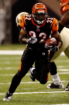 NEW ORLEANS - AUGUST 14:  Running back Cedric Benson #32 of the Cincinnati Bengals runs with the ball against the New Orleans Saints during a preseason game on August 14, 2009 at the Superdome in New Orleans, Louisiana. (Photo by Chris Graythen/Getty Imag