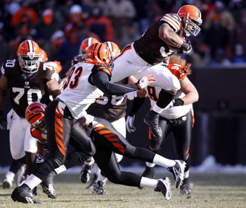 CLEVELAND - DECEMBER 21: Jamal Lewis #31 of the Cleveland Browns jumps over Chinedum Ndukwe #41 of the Cincinnati Bengals for a first quarter first down at Cleveland Browns Stadium December 21, 2008 in Cleveland, Ohio.  (Photo by Gregory Shamus/Getty Imag