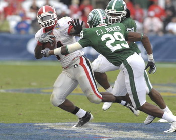 ORLANDO, FL - JANUARY 1: Running back Knowshon Moreno #24 of the University of Georgia rushes upfield against the Michigan State Spartans at the 2009 Capital One Bowl at the Citrus Bowl on January 1, 2009 in Orlando, Florida.  (Photo by Al Messerschmidt/G
