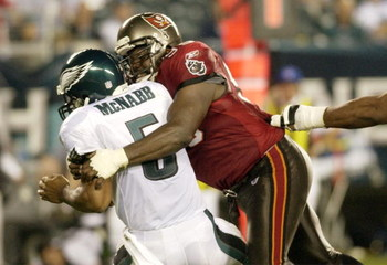 Tampa Bay Buccaneers defensive end  Warren Sapp pressures Philadelphia Eagles quarterback Donovan McNabb  September 8, 2003 at Lincoln Financial Field in Philadelphia.  The Bucs defeated the Eagles 17 - 0 to open the season on Monday Night football.  (Pho