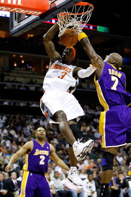 CHARLOTTE, NC - MARCH 31:  Lamar Odom #7 of the Los Angeles Lakers tries to block a dunk by Gerald Wallace #3 of the Charlotte Bobcats during their game at Time Warner Cable Arena on March 31, 2009 in Charlotte, North Carolina.  NOTE TO USER: User express