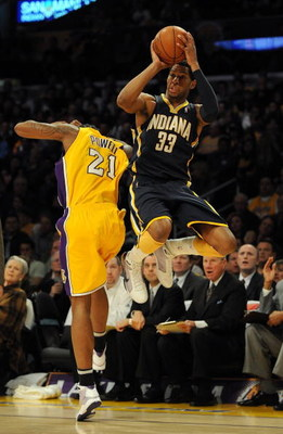 LOS ANGELES, CA - JANUARY 09:  Danny Granger #33 of the Indiana Pacers is fouled as he attempts a three pointer by Josh Powell #21 of the Los Angeles Lakers during the first half at the Staples Center on January 9, 2009 in Los Angeles, California.   NOTE