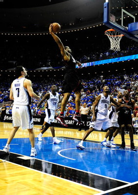 ORLANDO, FL - APRIL 28:  Andre Iguodala #9 of the Philadelphia 76ers dunks against the Orlando Magic in Game Five of the Eastern Conference Quarterfinals during the 2009 NBA Playoffs at Amway Arena on April 28, 2009 in Orlando, Florida. NOTE TO USER: User