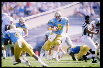 29 Oct 1988:  Quarterback Troy Aikman of the UCLA Bruins runs down the field during a game against the Washington State Cougars at the Rose Bowl in Pasadena, California.  Washington State won the game 34-30. Mandatory Credit: Mike Powell  /Allsport